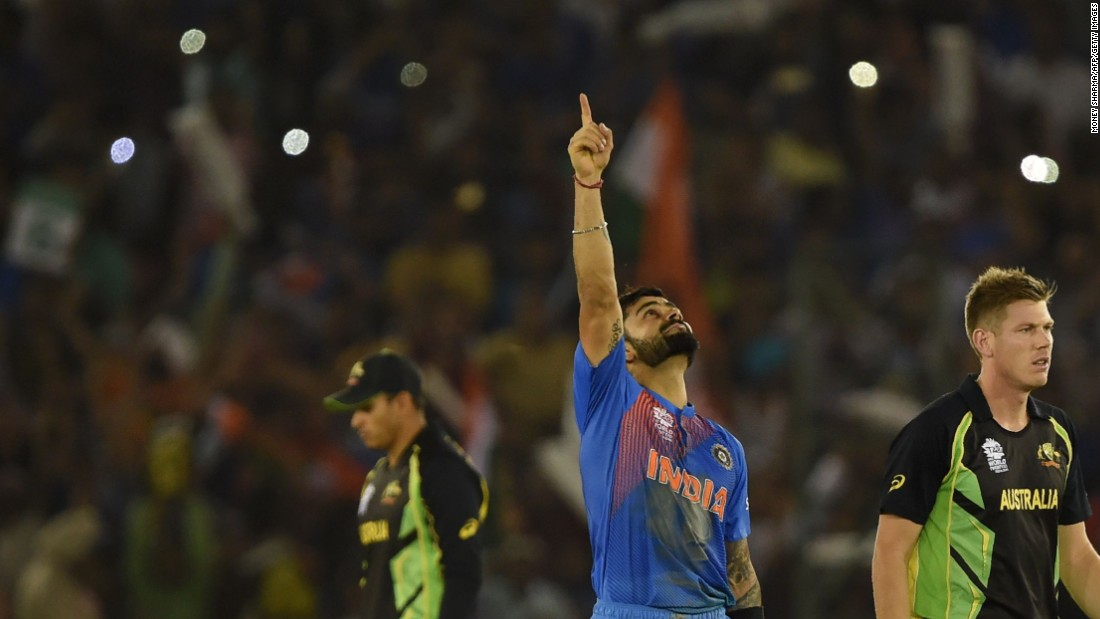 Virat Kohli points to the heavens after guiding India to its crucial group victory over Australia in the Twenty20 World Cup.