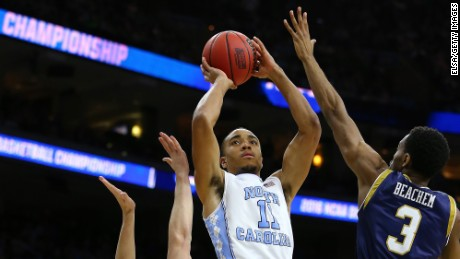 Brice Johnson of the North Carolina Tar Heels shoots against Steve Vasturia and V.J. Beachem of the Notre Dame Fighting Irish during the 2016 NCAA Men's Basketball Tournament East Regional Final on March 27.
