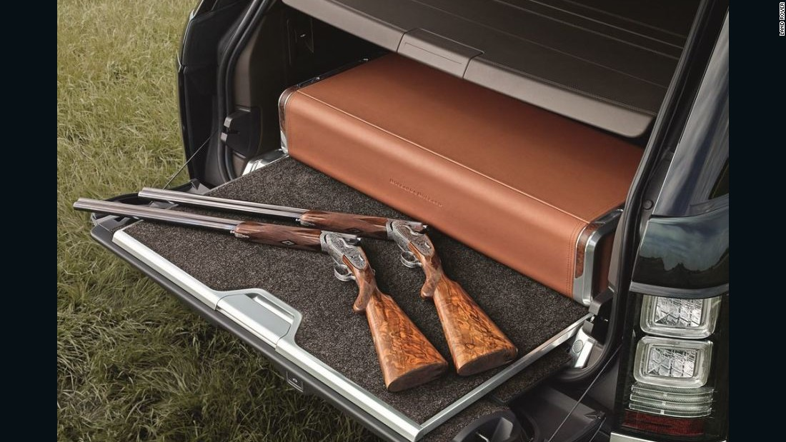 The Holland & Holland Range Rover features a deployable, locking, leather trimmed case designed to hold a pair of shotguns (not included) that feature Holland & Holland's signature acanthus scroll engraving.