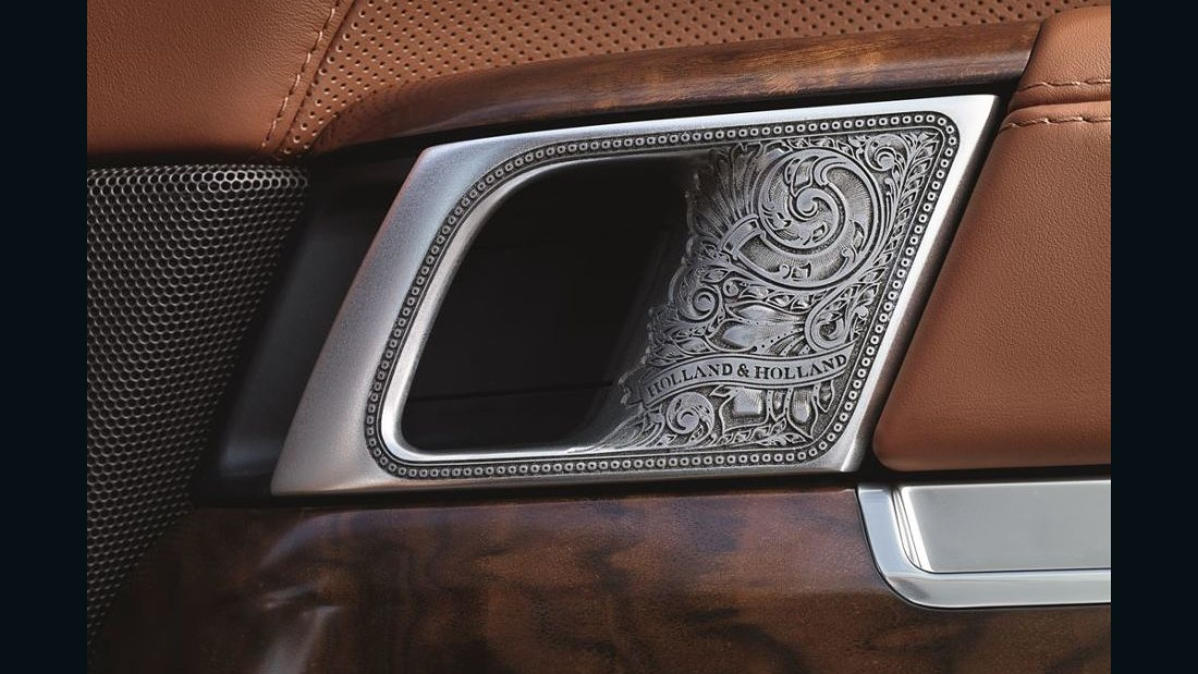There's also a custom dashboard trim panel, polished French walnut veneers, extended leather upholstery and trim in an espresso and tan combination unique to the model.