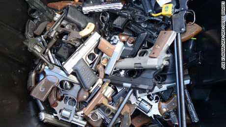 A trash bin full of handguns collected during the LAPD Gun Buyback Program event in Van Nuys area, north of Los Angeles, on December 26, 2012.  By noon LAPD collected more then 420 handguns, rifles and shotguns such as TEC-9, Assault rifle, Uzi, WWI rifle.  Apart from it, there are 16 assault weapons and some vintage weapons.  One is dated 1895.    AFP PHOTO / JOE KLAMAR        (Photo credit should read JOE KLAMAR/AFP/Getty Images)