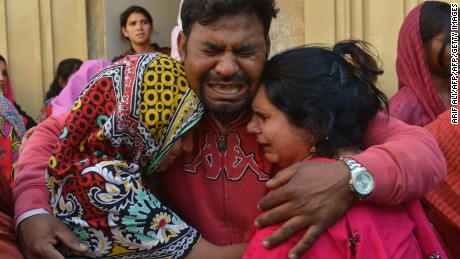 Pakistani Christians mourn the death of a blast victim of the March 27 suicide bombing, in Lahore on March 28, 2016.  Pakistan's army launched raids and arrested suspects after a Taliban suicide bomber targeting Christians over Easter killed 72 people including many children in a park crowded with families. / AFP / ARIF ALI        (Photo credit should read ARIF ALI/AFP/Getty Images)