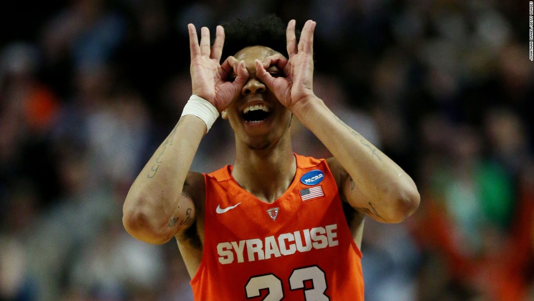 Malachi Richardson celebrates a 3-pointer during Syracuse's 68-62 victory over Virginia on Sunday, March 27. Richardson, a freshman, scored 21 second-half points as the Orange came back from 16 down to clinch a spot in the Final Four.