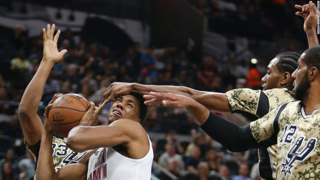 Miami's Hassan Whiteside has his shot blocked during an NBA game in San Antonio on Wednesday, March 23.