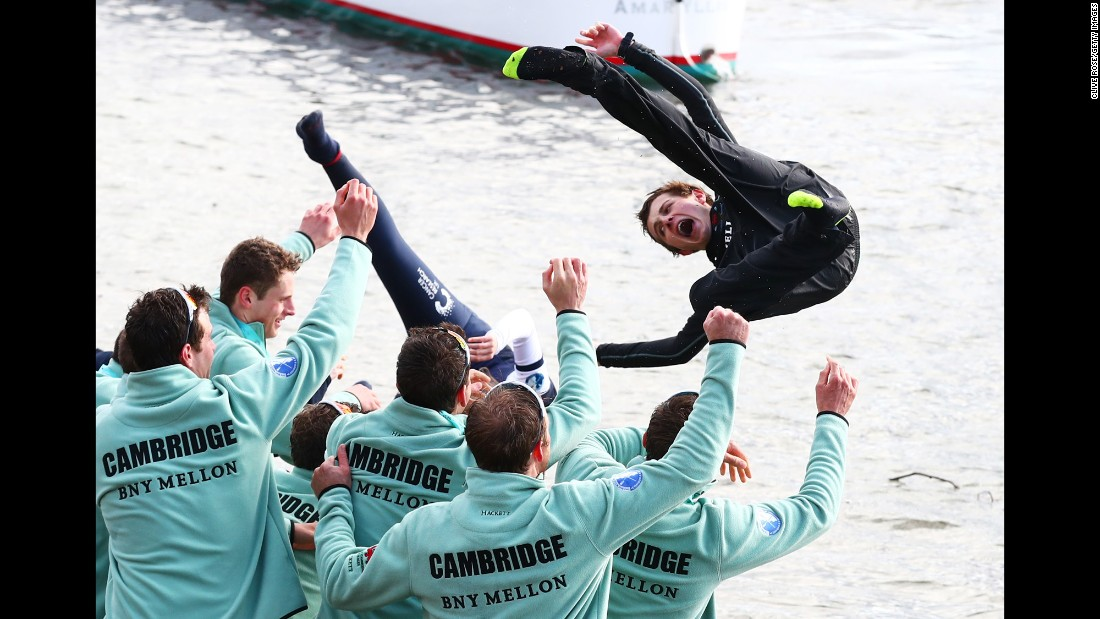 Ian Middleton, the cox of the victorious Cambridge crew, is thrown into the River Thames after beating Oxford in London's historic Boat Race on Sunday, March 27.