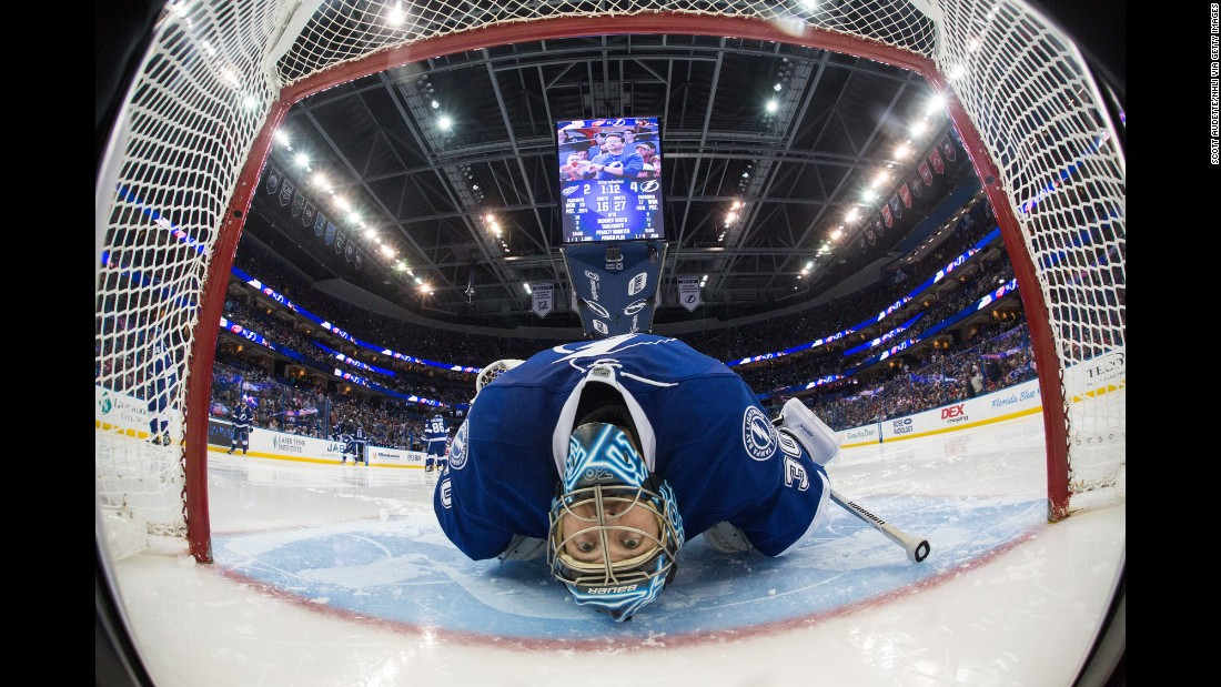 Tampa Bay goalie Ben Bishop stretches before the third period of an NHL game on Tuesday, March 22.