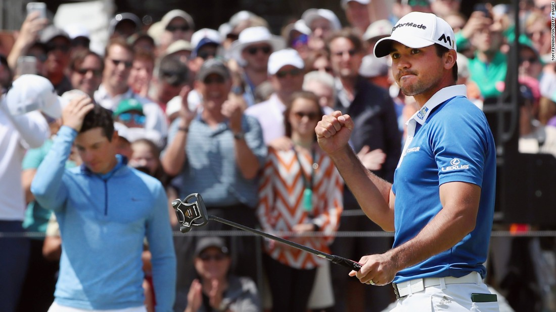 Jason Day, right, celebrates after sinking a putt to beat Rory McIlroy, left, in the semifinals of the WGC Match Play on Sunday, March 27. Day went on to beat Louis Oosthuizen in the final and move to No. 1 in the world rankings.
