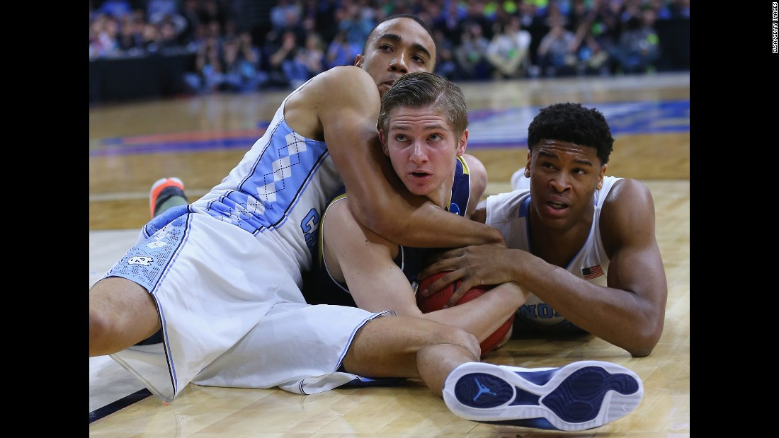 Notre Dame's Rex Pflueger, center, is tied up by North Carolina's Brice Johnson, left, and Isaiah Hicks during their Elite Eight game on Sunday, March 27. North Carolina advanced to the Final Four with an 88-74 victory.