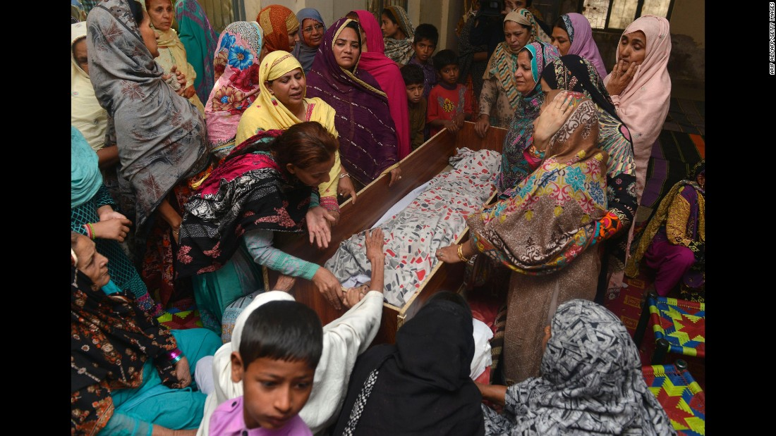 Pakistanis mourn over the body of a relative during a funeral in Lahore on March 28.