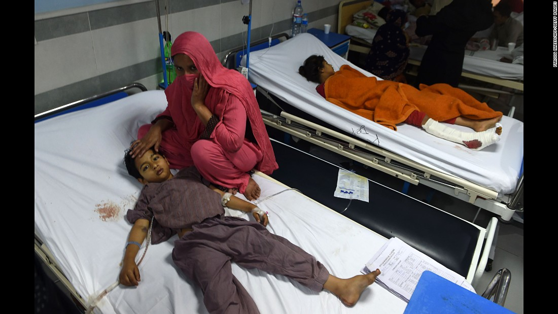 An injured child is comforted in a hospital in Lahore on March 28.