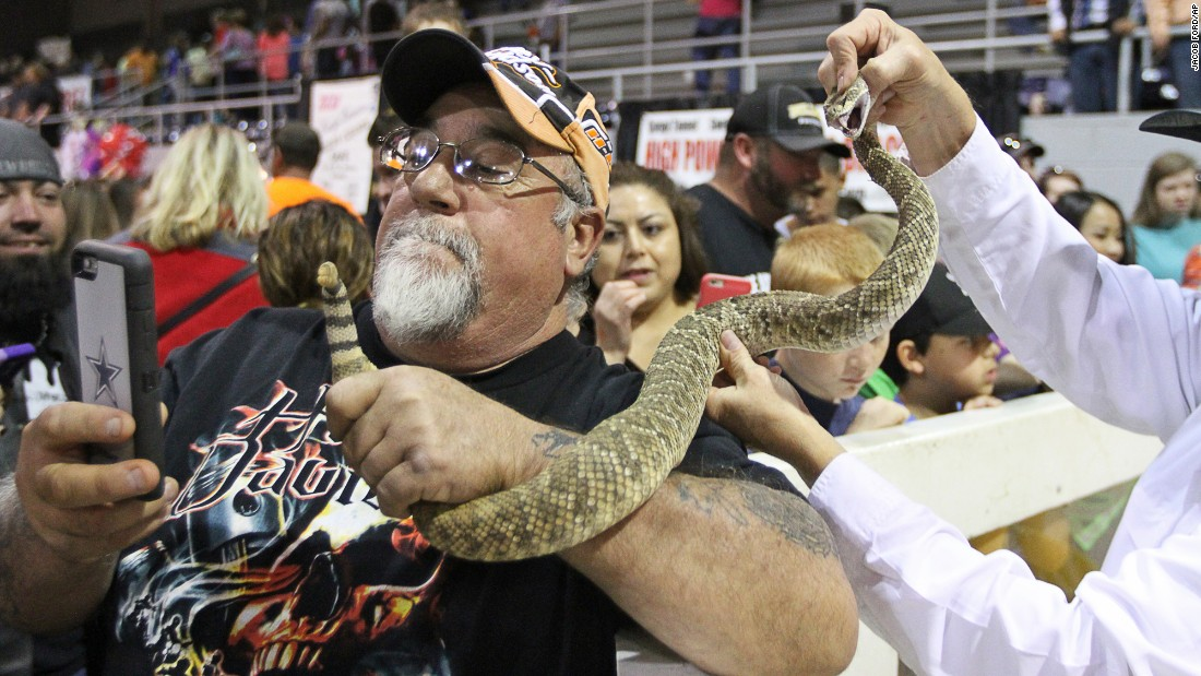 A man takes a selfie with a rattlesnake in Sweetwater, Texas, on Saturday, March 12. The man was attending the World's Largest Rattlesnake Round-Up, an annual event hosted by the Sweetwater Jaycees.