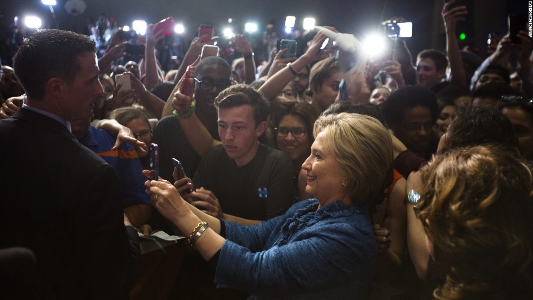 Democratic presidential candidate Hillary Clinton takes a selfie with supporters in West Palm Beach, Florida, on Tuesday, March 15. She had just won the Florida primary.