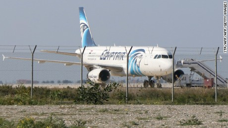 An Egypt Air Airbus A-320 sits on the tarmac of Larnaca aiport after it was hijacked and diverted to Cyprus on March 29, 2016.  / AFP / STR        (Photo credit should read STR/AFP/Getty Images)