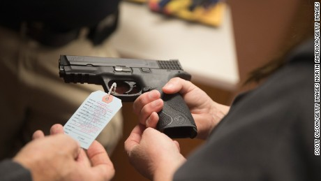 BRIDGETON, MO - NOVEMBER 12:  Customers shop for a handgun at Metro Shooting Supplies on November 12, 2014 in Bridgeton, Missouri. The suburban St. Louis store is located near Ferguson, Missouri where several weeks of sometimes violent protests erupted following the shooting death of Michael Brown by Ferguson police officer Darren Wilson on August 9th. The gun shop last week experienced a 300 percent increase in sales over the same period last year. About 60 percent of those sales were from first-time gun owners. The increase is attributed in part to concern from residents of additional outbreaks of violence if the grand jury investigating Brown's death does not find justification to prosecute Wilson for the shooting. The grand jurys decision is expected sometime in November.  (Photo by Scott Olson/Getty Images)2