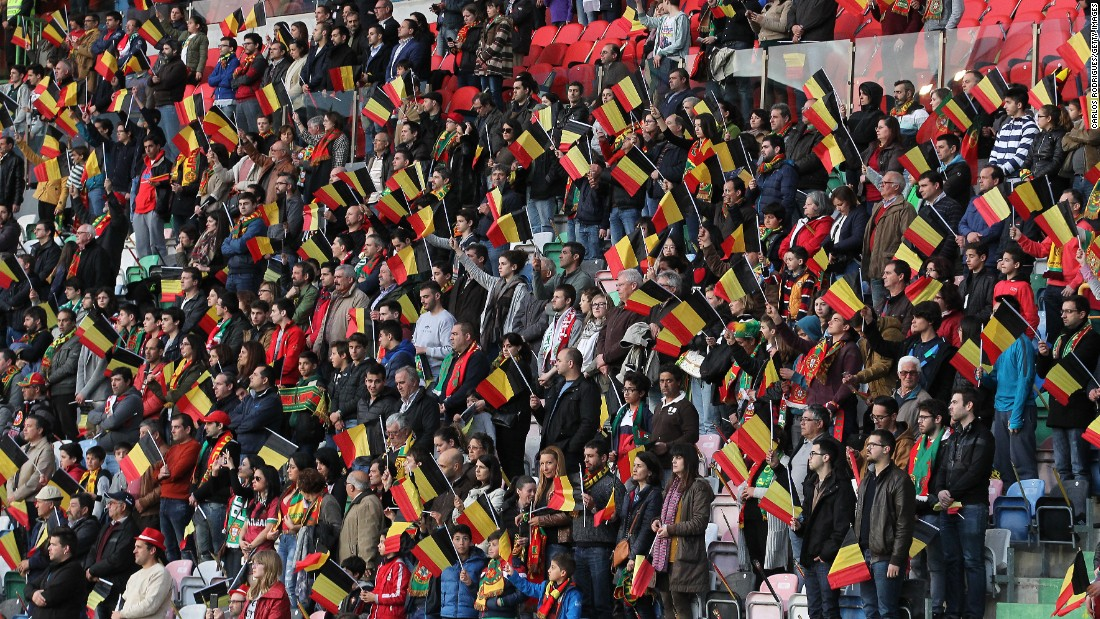Portuguese supporters wave Belgian flags.