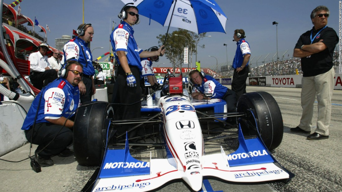 Andretti looks on as son Michael prepares for the 2002 IndyCar Long Beach Grand Prix, a race Michael would go on to win, just like his Dad. Michael Andretti is now president of the Andretti Formula E team.