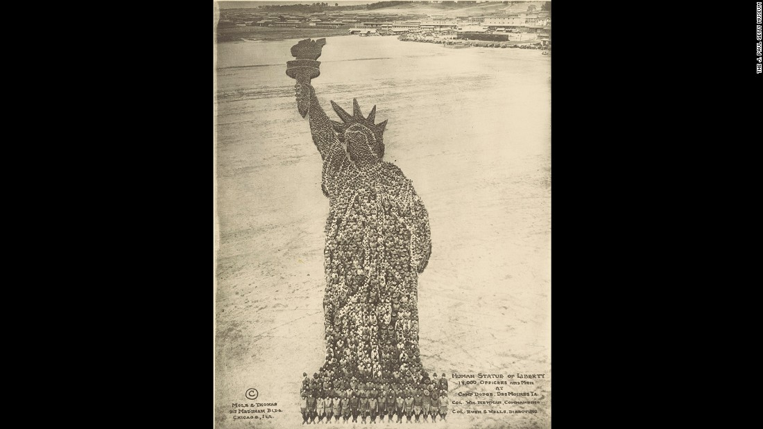 "Arthur Mole became famous during World War I when he started making ""living photographs,"" where tens of thousands of military personnel were arranged to form compositions. The ""Human Statue of Liberty,"" made in 1918, involved 18,000 people from Camp Dodge in Des Moines, Iowa. It was created with the help of John D. Thomas."