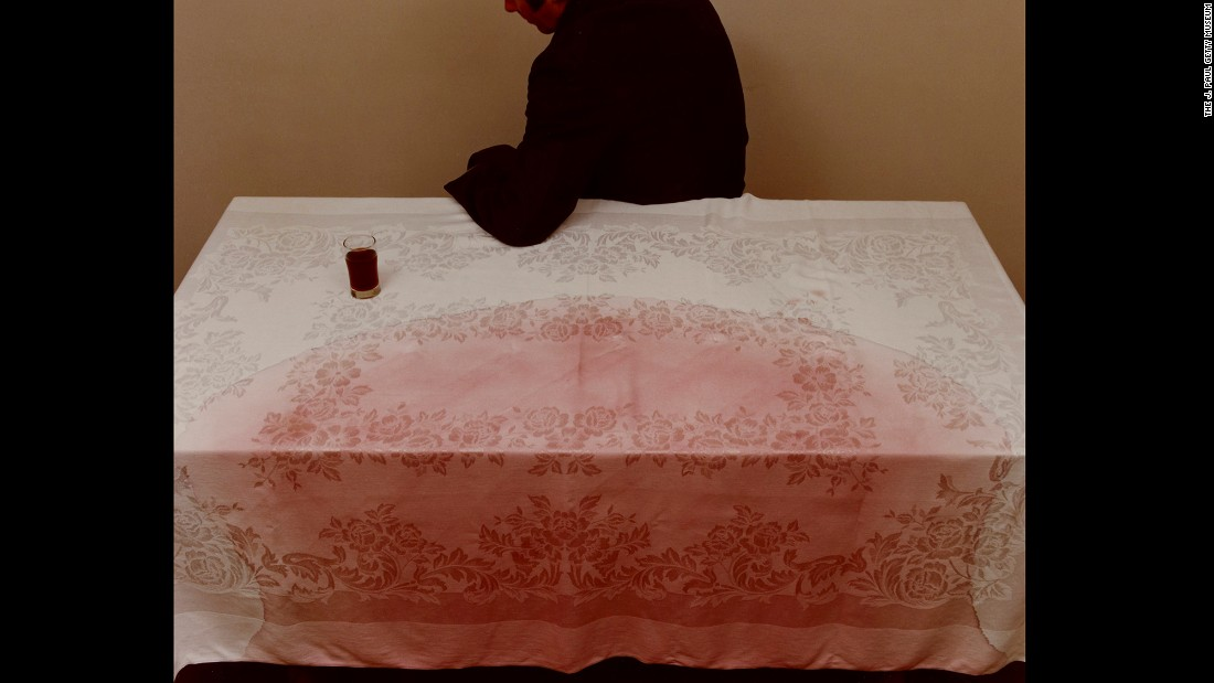 "This image, from Jo Ann Callis, is titled ""Man at Table, after David Evans."" Callis emerged in the late '70s as one of the first important practitioners of the ""fabricated photographs"" movement, according to the Getty Museum. ""The images are more about the routine of life, the actions in which we partake every day,"" she said about her work. ""I set my photos in a home because having a home is something for which I'm so grateful and consider a backbone to my life."""