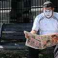 Mime-reading-newspaper