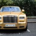 gold car rolls royce