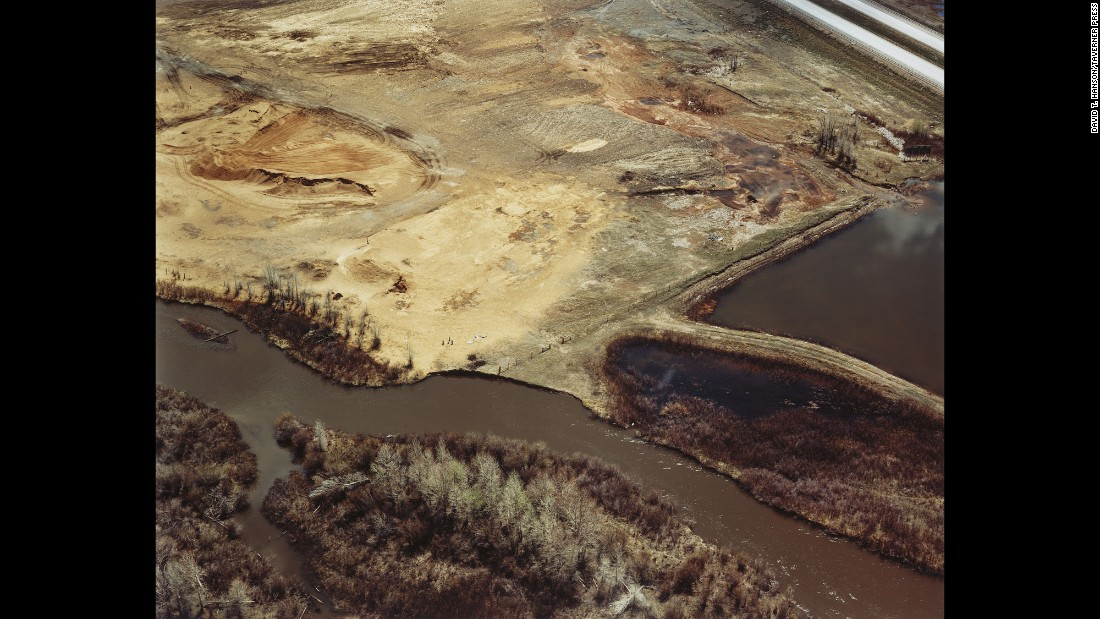 "The Baxter/Union Pacific Tie Treating <a href=""https://cumulis.epa.gov/supercpad/cursites/csitinfo.cfm?id=0800792"" target=""_blank"">Superfund site</a> is photographed near the Laramie River in Laramie, Wyoming, in 1986. ""Historical spills and disposal practices contaminated soil and groundwater with hazardous chemicals,"" according to the EPA. ""Cleanup is ongoing under the Resource Conservation and Recovery Act program, administered by the Wyoming Department of Environmental Quality. EPA took the site off the Superfund program's National Priorities List in December 1999."""