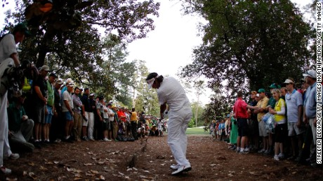 Bubba Watson carves a shot around the trees on his way to winning a playoff in 2012.