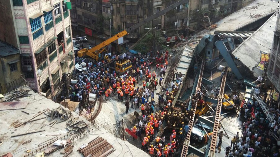 Residents and rescue workers clear rubble after the collapse.