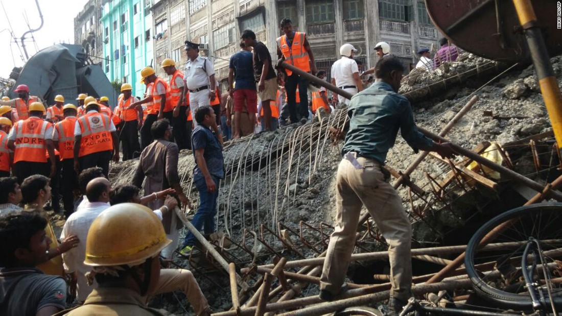 Rescue workers and residents work to clear the rubble on March 31.