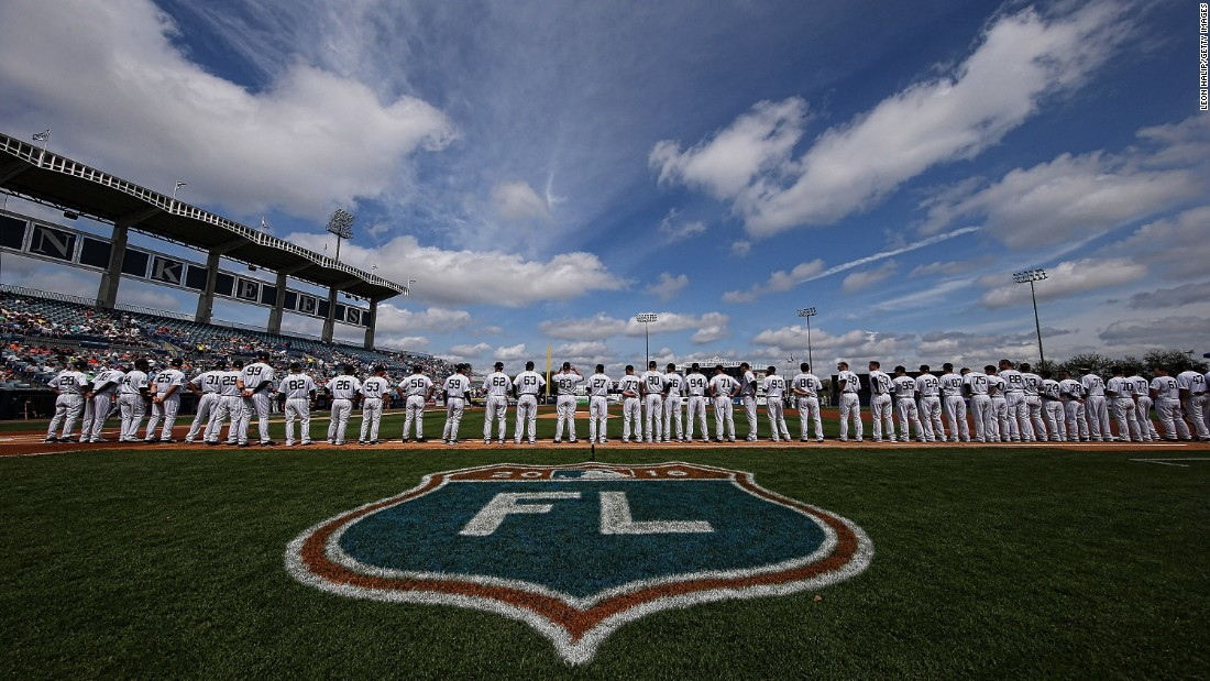 Members of the New York Yankees line up for the national anthem prior to the start of a game in Tampa, Florida, on March 2.