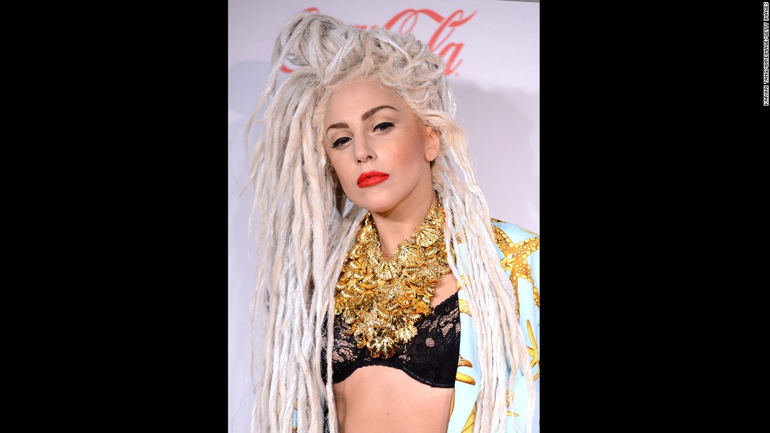 Lady Gaga is pictured attending the 2013 Jingle Bell Ball in London wearing a dreadlock style.