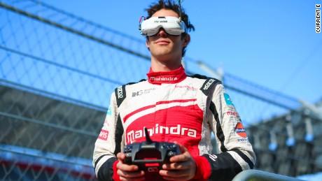 Formula E car vs. drone