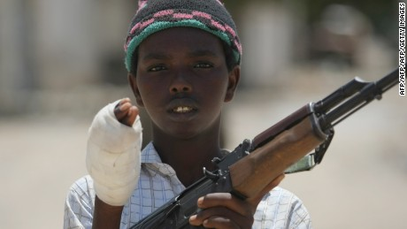 "A young fighter from the Al-Shabab militia shows the wound in his hand which he suffered while battling Somali government forces in a frontline section in Sinaya Neighborhood in Mogadishu, on July 13, 2009. According to the Islamist militants, Al-Shabab fighters and Hizbul Islam fighters regained some of their position overnight which they had lost to the government soldiers over the weekend. Paramedics, police and government forces said the fighting Sunday spread across several districts of the city and claimed many lives.  ""The ambulances collected 75 injured civilians and 14 dead bodies of civilians,"" Ali Muse, the head of the city's ambulance service, told AFP. ""Some of them were killed by mortar and artillery shells and others by crossfire.""    AFP PHOTO/Mohamed DAHIR        (Photo credit should read MOHAMED DAHIR/AFP/GettyImages)"
