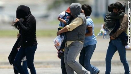 Immigrant children and their mothers arrive in Guatemala after being deported from the United States in 2014. The migrants had come to the U.S. to flee a humanitarian crisis in their homeland.
