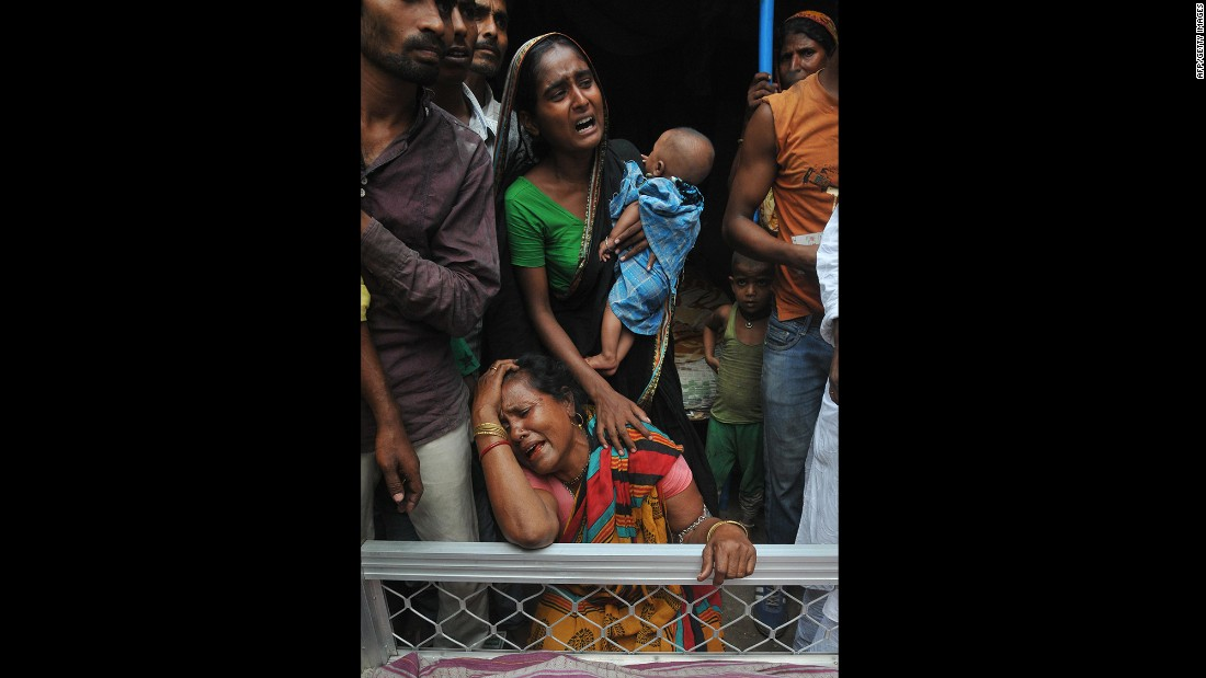 Relatives of a man killed in the collapse mourn next to his body on April 1.