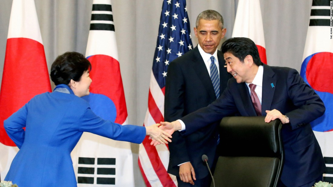 "U.S. President Barack Obama watches Japanese Prime Minister Shinzo Abe, right, shake hands with South Korean President Park Geun-hye during a meeting in Washington on Thursday, March 31. The meeting looked to <a href=""http://www.cnn.com/2016/03/31/politics/nuclear-summit-trump-japan-south-america/index.html"" target=""_blank"">reinforce an alliance</a> that has stabilized Asia for decades and now faces new challenges in an assertive China and an increasingly erratic North Korea."