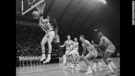 Texas Western's David Lattin, behind Kentucky's Thad Jaracz, goes up for a rebound on his team's way to winning the 1966 NCAA men's baksetball championship. Texas Western started five black players, the first time in tournament's history.