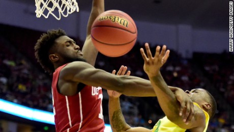 While mourning the loss of his grandmother, Oklahoma's Khadeem Lattin, left, is following his grandfather's historic footsteps as he and the Sooners seek their first men's basketball national title.
