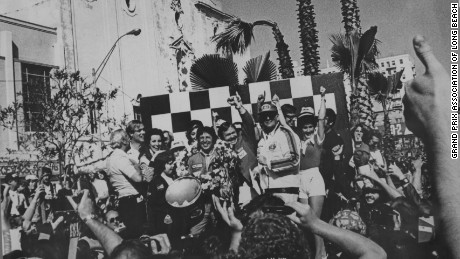 Happy days! Mario Andretti celebrates his win at the 1977 United States GP West at Long Beach.