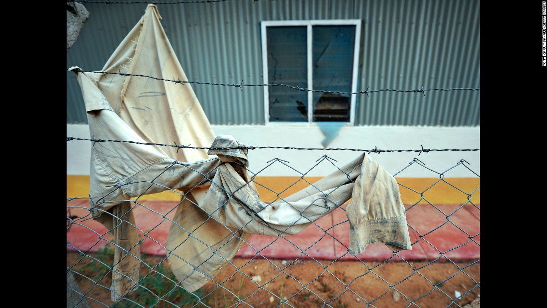 A garment remained on the barbed wire fence near one of the dormitories targeted in the deadly siege.