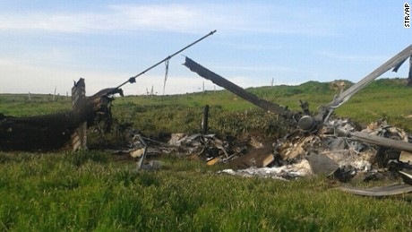 A downed Azerbaijani helicopter lies in a field in the Nagorno-Karabakh region Saturday.