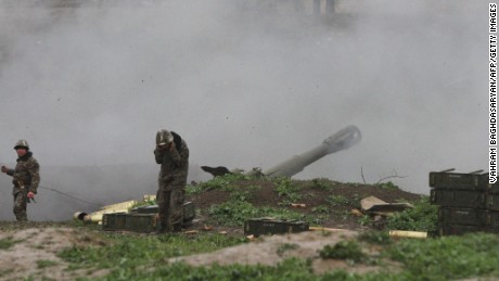 Armenian servicemen fire an artillery shell towards Azeri forces from the town of Martakert on Sunday.