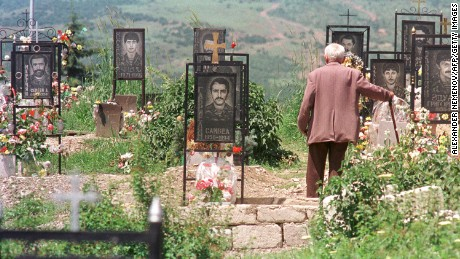 An Armenian man visits his son's grave at a memorial cemetery in Stepanakert, Azerbaijan, the capital of Nagorno Karabakh, in June 1994.