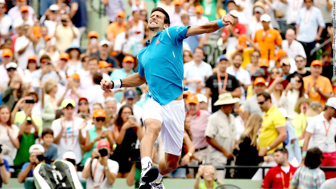 Novak Djokovic celebrates victory against Kei Nishikori of Japan in the final of the 2016 Miami Open.
