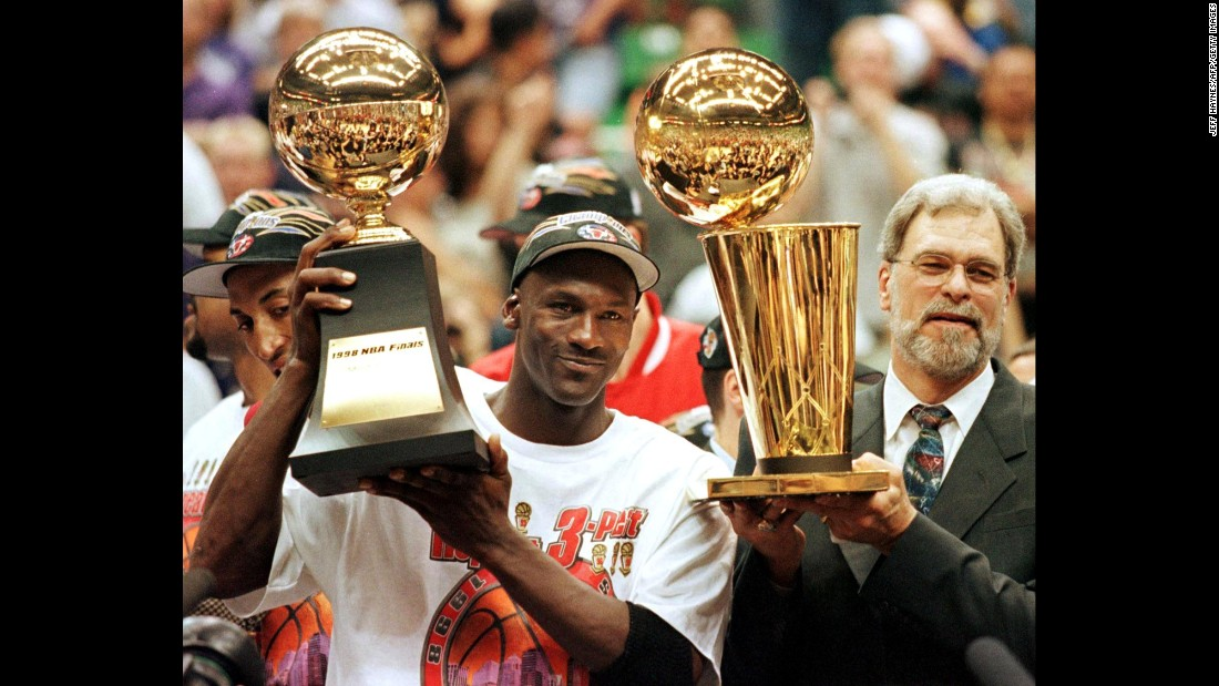 <strong>Most Finals MVP awards: </strong>Michael Jordan was named the Most Valuable Player for all six Finals he played in. The Bulls guard holds his 1998 award here next to head coach Phil Jackson.