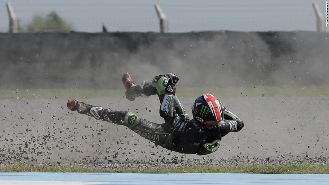 Bradley Smith falls off his motorcycle during a MotoGP qualifying session on Saturday, April 2. He raced the next day and finished eighth in the Argentina Grand Prix.