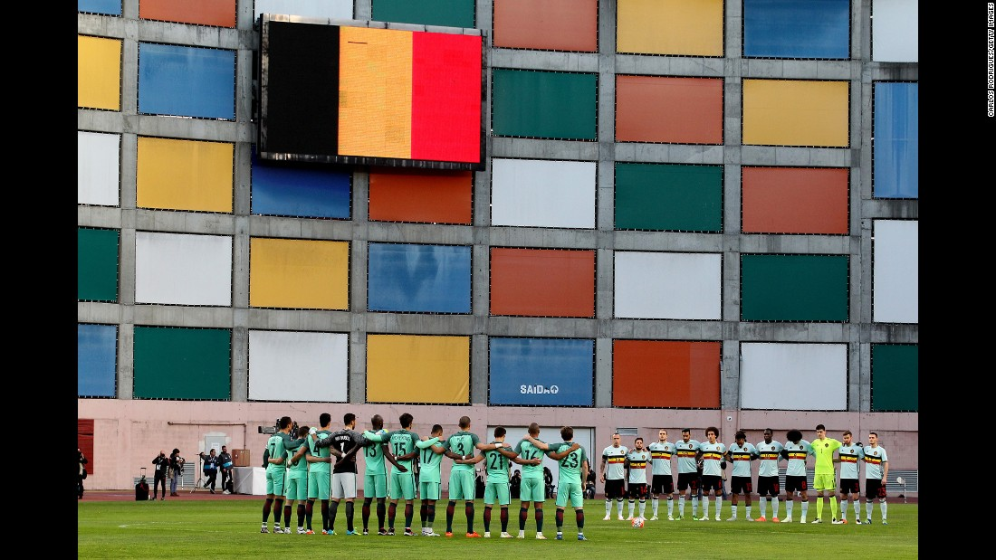"The Belgian national soccer team, right, and the Portuguese national team observe a minute of silence Tuesday, March 29, for the victims of the Brussels terror attacks. The international friendly match, initially scheduled for the Belgian capital, <a href=""http://www.cnn.com/2016/03/29/football/gallery/football-brussels-paris-portugal/index.html"" target=""_blank"">was moved to Leiria, Portugal.</a>"