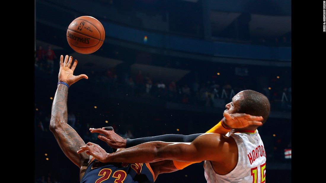 Atlanta's Al Horford fouls Cleveland's LeBron James during an NBA game in Atlanta on Friday, April 1.