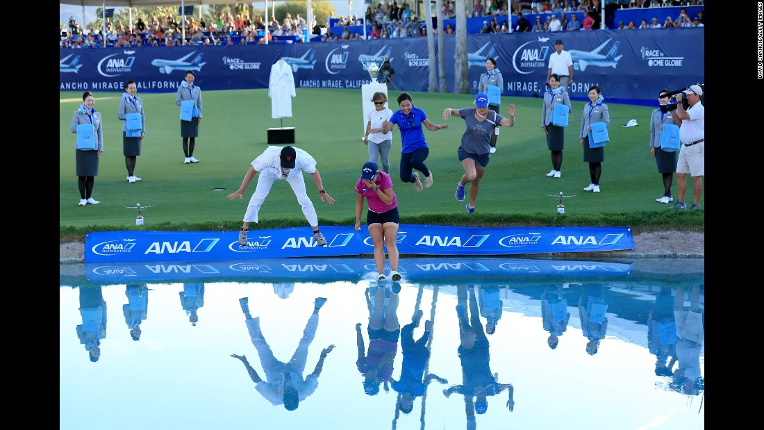 "Lydia Ko leads the leap into Poppie's Pond after winning the ANA Inspiration, a golf tournament in Rancho Mirage, California, on Sunday, April 3. It's the <a href=""http://www.cnn.com/2016/04/04/golf/lydia-ko-golf-ana-inspiration-california-lpga/index.html"" target=""_blank"">second major in a row</a> for Ko, an 18-year-old from New Zealand who won the Evian Championship in September."