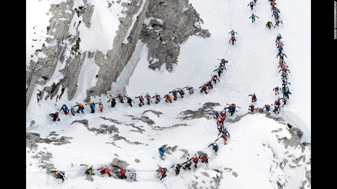 Skiers climb Sunday, April 3, during the Trophees du Muveran, a mountaineering race in the Swiss Alps.