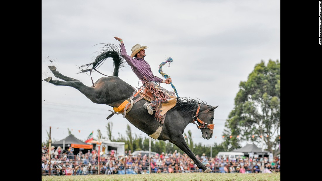 A competitor rides a bronco during the Lang Lang Rodeo, one of Australia's oldest rodeos, on Monday, March 28.